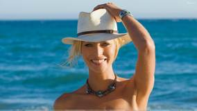 Lisa Seiffert Laughing In White Hat Near Sea Side